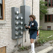 Meter reader reading an analog meter